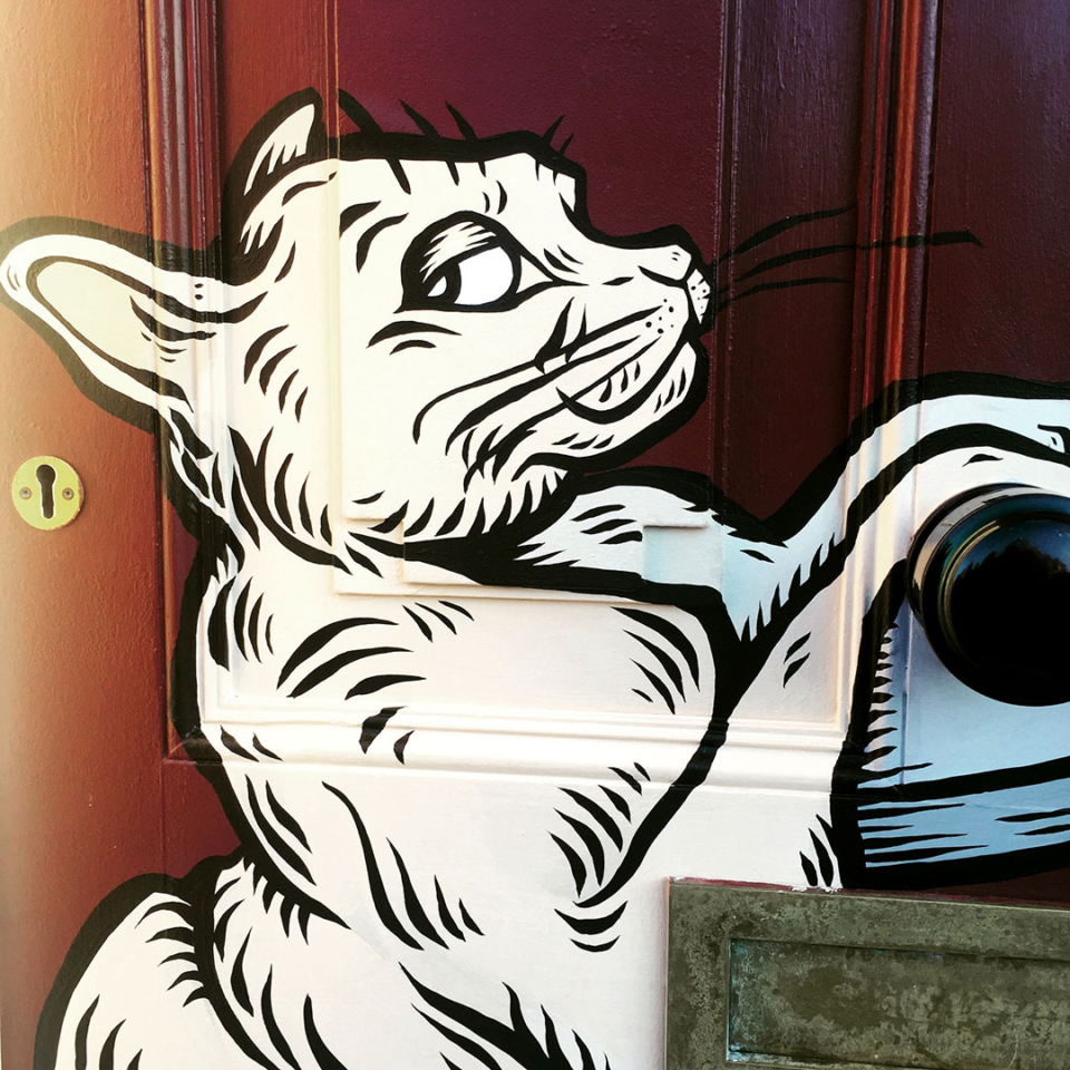 two burmese cats painted on a door in Bristol
