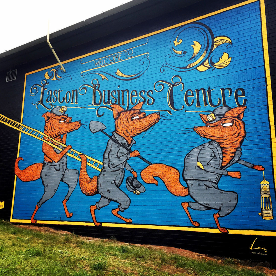 Three foxes dressed as miners feature in this mural