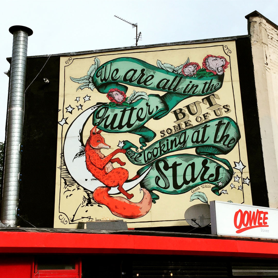 A five metre square mural featuring a fox sitting on the moon quoting Oscar Wilde