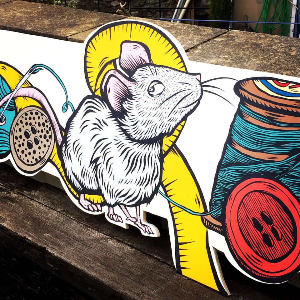 Mouse with needle and threads painted for a shop front
